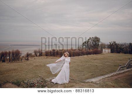 Bride Walking In Golden Autumn Nature