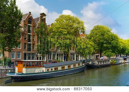 Amsterdam canal with houseboats, Holland