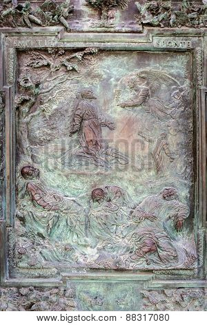 PISA, ITALY - APRIL 11, 2015: Reliefs on doors to the Cathedral at the Leaning Tower of Pisa, Italy. Pisa is a city in Tuscany known worldwide for the Leaning Tower, one of the biggest landmark.