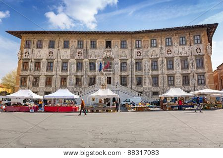 PISA, ITALY - APRIL 11, 2015: Historical Scuola Normale building in Pisa, Italy. The Scuola Normale Superiore di Pisa is a public higher learning institution in Pisa.