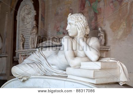 PISA, ITALY - APRIL 11, 2015: Tomb sculptures in the Monumental Cemetery at the Leaning Tower of Pisa, Italy. Pisa is a city in Tuscany known worldwide for the Leaning Tower landmark.