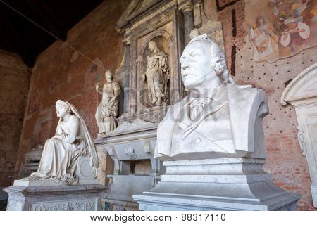 PISA, ITALY - APRIL 11, 2015: Sculpture in the Monumental Cemetery at the Leaning Tower of Pisa, Italy. Pisa is a city in Tuscany known worldwide for the Leaning Tower, one of the biggest landmark.