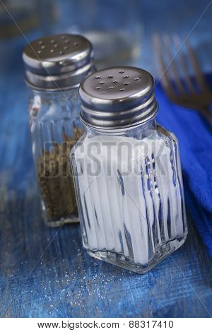 Salt and Pepper Shakers on a Table Top Setting