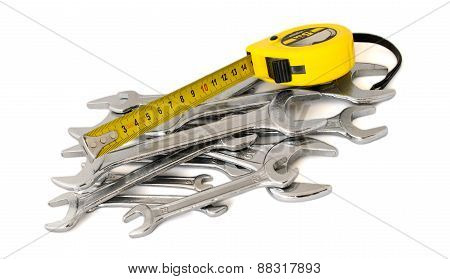Spanner, wrench, key and roulette, tape-measure on a white background