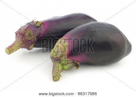 fresh aubergines on a white background