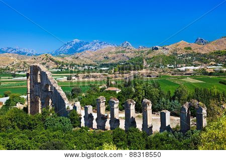 Aqueduct at Aspendos in Antalya Turkey - archaeology background