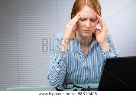 Businesswoman With Migraine Or Headache