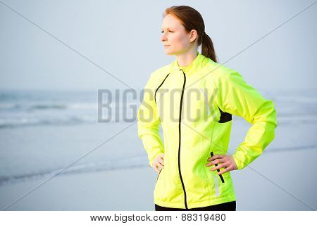 Active Woman Doing Sports By The Sea