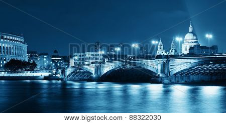 Blackfriars Bridge and St Pauls Cathedral in London at night.