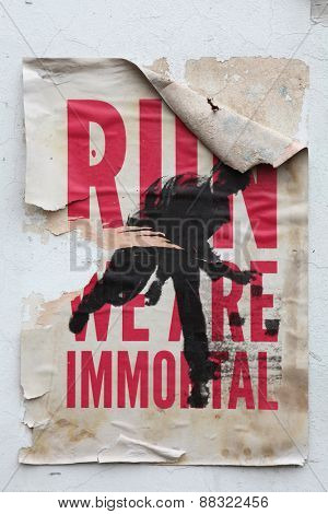 PRAGUE, CZECH REPUBLIC - DECEMBER 20, 2012: Poster Run! We are Immortal! on a wall in Prague, Czech Republic.