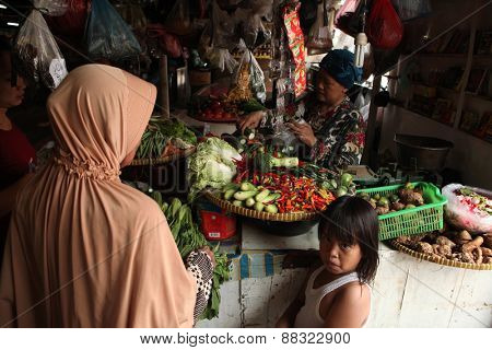 JAKARTA, INDONESIA - AUGUST 17, 2011: Vendor sells vegetables at the Pasar Pramuka Market in Jakarta, Central Java, Indonesia.
