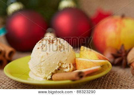 Scoop of cinnamon ice cream with apple for dessert at christmas