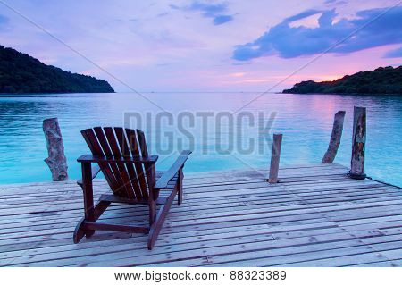 Lonely Scene ; Single Wooden Chair In The Port Over Sea At Twilight