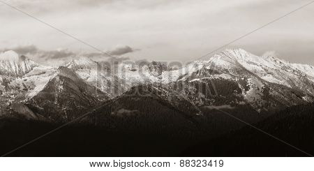 Kings Canyon mountain with snow and cloud at sunset