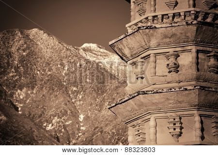 Dali Old Town with pagoda and snow capped Cangshan in Yunnan, China.