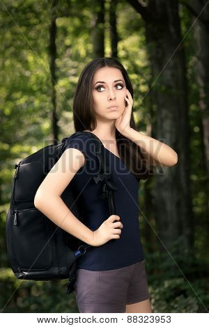 Disoriented Hiking Girl with Travel Backpack