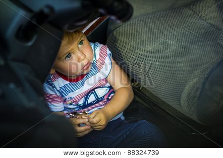 Little Boy Sits In The Car