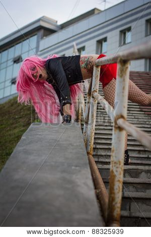 The Girl In The Wig On The Stairs