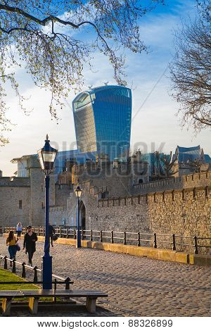 Walkie Talkie building and Tower of London. River Thames side walk.