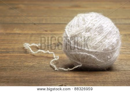 White Wool Roll On Wood Background