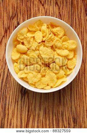 Yellow Corn Flakes In The White Bowl
