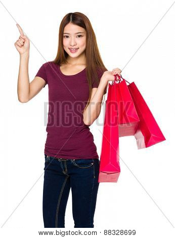 Shopper with shopping bag and finger point up