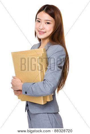Young business woman holding a report