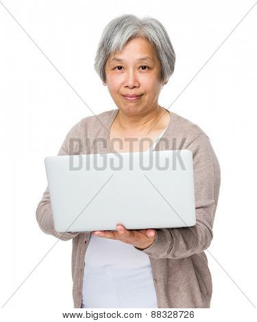 Asian old woman learn to use of laptop