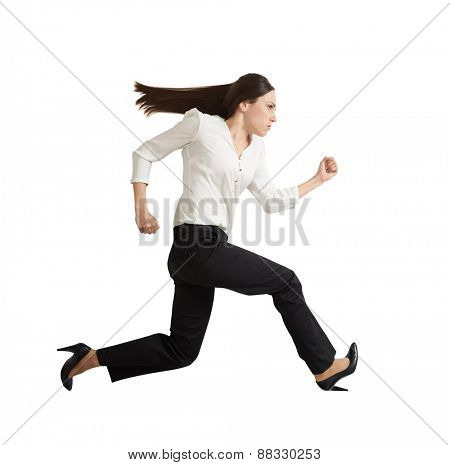sideview of concentrated running businesswoman looking forward. isolated on white background