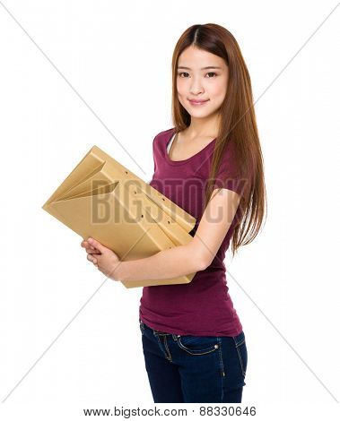 Young student holding document work