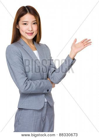 Smiling woman showing copy space for product