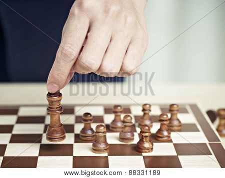 Hand of a man Moving A Chess Piece