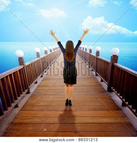 Woman Raise Hand On The Pier