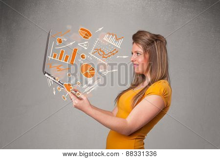 Beautiful young lady holding laptop with graphs and statistics