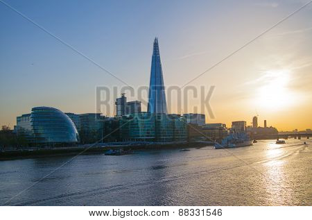 LONDON, UK - APRIL15, 2015: Shard of glass in sunset. Panoramic view of south bank river Thames walk