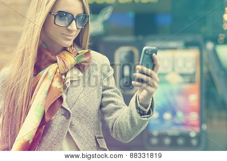 Woman With Cell Phone Walking