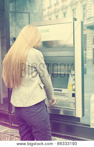 Woman Using Bank Atm Machine