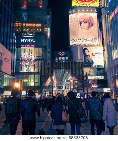 Urban Scene At Night With Many People Around Kansai In Osaka, Japan