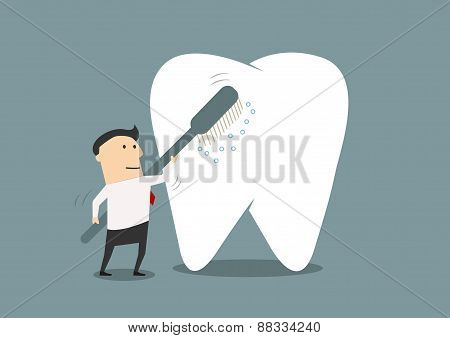 Businessman cleaning a big tooth with toothbrush