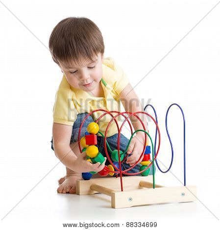 child boy playing with colorful toy