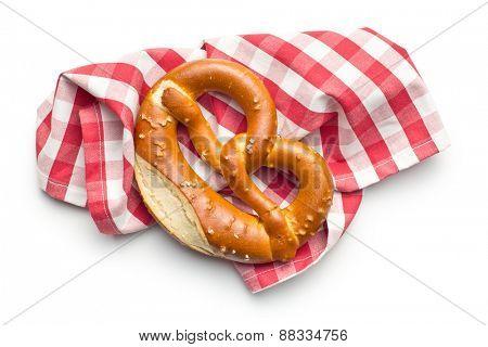 baked pretzel with napkin on white background