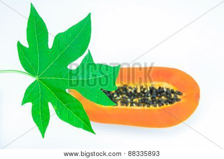 Haft Cut Papaya Fruit And Papaya Leaf Isolated Over White Background,focus On Papaya Leaf.