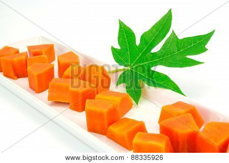 Sweet Papaya Slice On White Ceramic Dish Bord Isolated On White Background