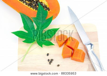 Sweet Papaya Slice On Chopping Bord Isolated On White Background