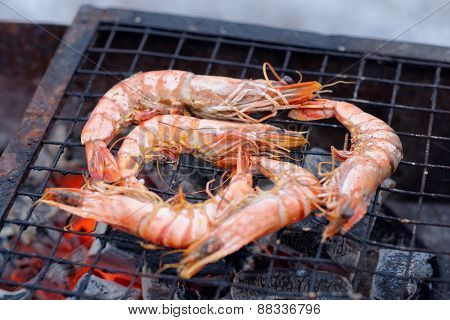Shrimps on charcoal grill, outdoor picnic