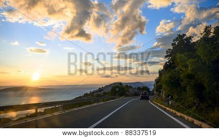 Beautiful coastal road at sunset