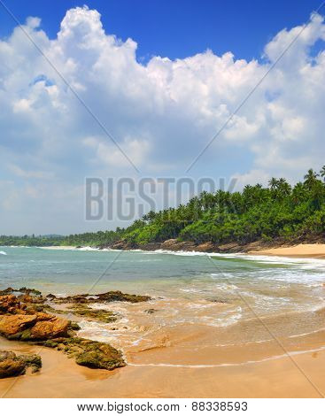 beautiful landscape with sea waves on tropical beach with stones and rocks