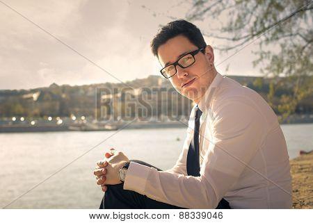 Businessman at the riverside