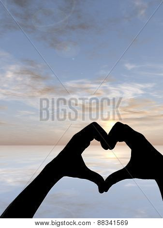 Concept or conceptual heart shape or symbol made of human or woman and man hand silhouette over a sky and sea at sunset background