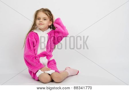 Six Year Old Girl In A Bathrobe Straightens Hair